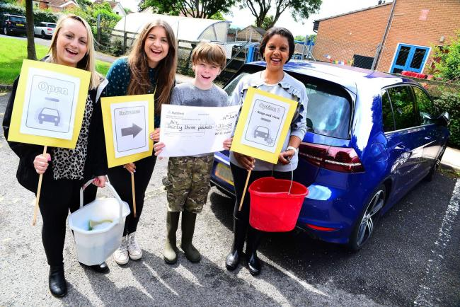 CAR WASH: Will Garner with ARC's Rosie Hather and Rosie Sandy and teaching assistant Sharon Legrad