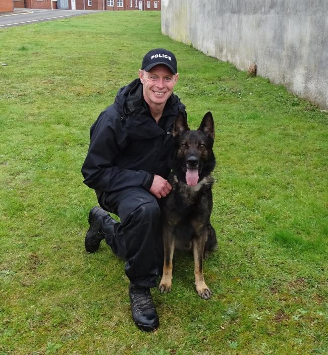 POLICE DOG: Grommit with his handler PC Lee Adamson