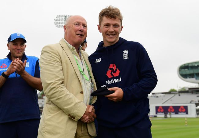 PAST AND PRESENT: Former Somerset spinner Vic Marks presents Dom Bess with his England Test cap.