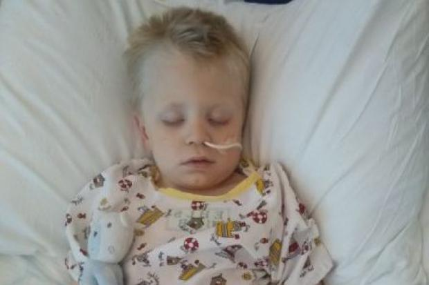 MIRACLE CHILD: Ethan in his hospital bed