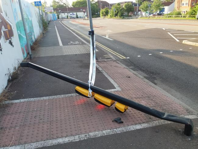DAMAGED: The pedestrian crossing light knocked down in Castle Street, Taunton