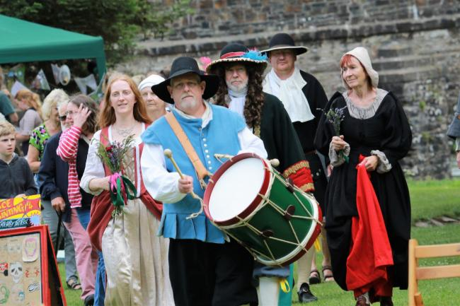 CELEBRATIONS: Lorna Doone arrives for her wedding during the Taunton Garrison performance
