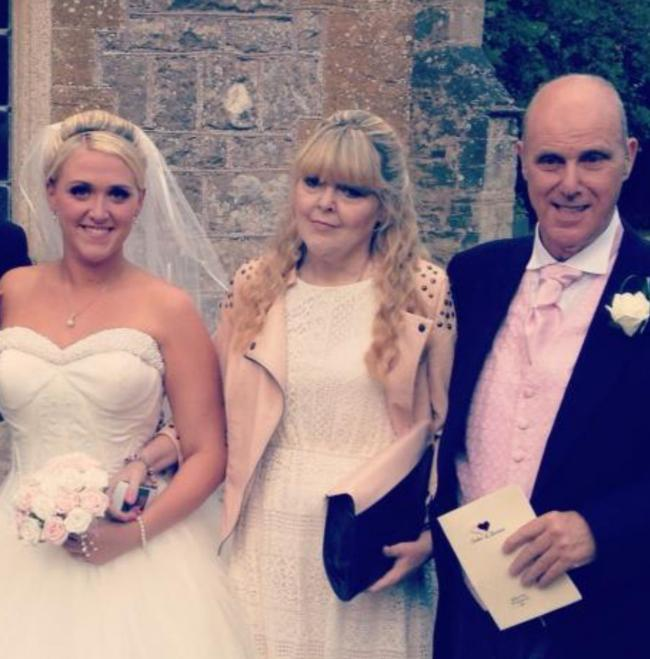 SUCCESS: Kayleigh Wheeler at her wedding along with her parents Gill and Les