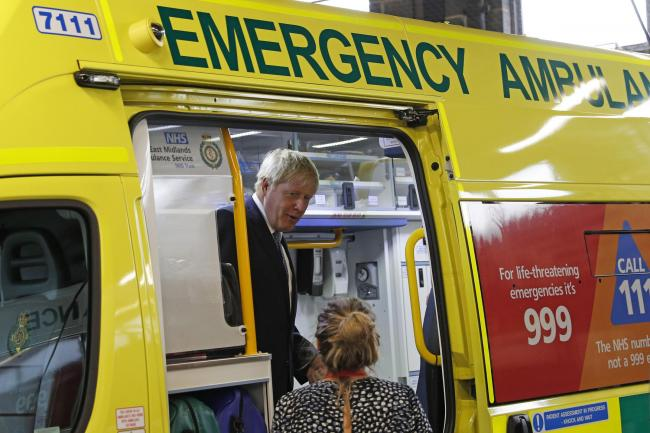 PLEDGE: Prime Minister Boris Johnson inspects an ambulance during a visit to Pilgrim Hospital in Boston, Lincolnshire. PICTURE: Darren Staples/PA Wire