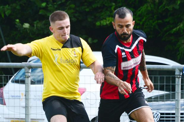 HAT-TRICK: Amauri Ruiz (right) in action for Bishops Lydeard Reserves on Saturday, up against Burnham United Reserves' Darren Partridge. All pics: Steve Richardson
