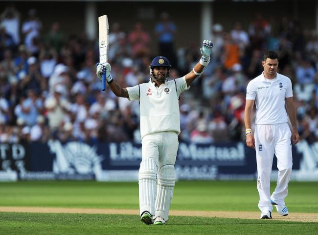 INCOMING: Murali Vijay raises his bat after reaching a century for India against England in 2014. Pic: Nigel French/PA Wire