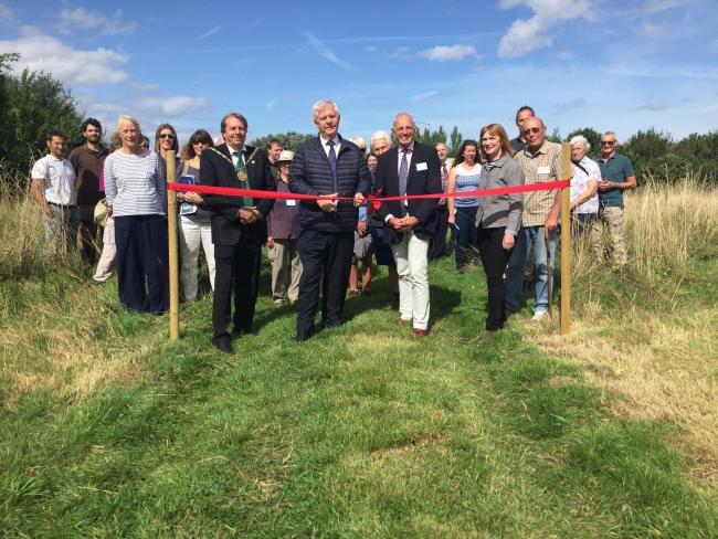 OPEN: Cllr David Fothergill cuts the ribbon accompanied by Sedgemoor District Council chairman Cllr Peter Clayton, EDF's David Eccles and Rights of Way officer Sarah Littler