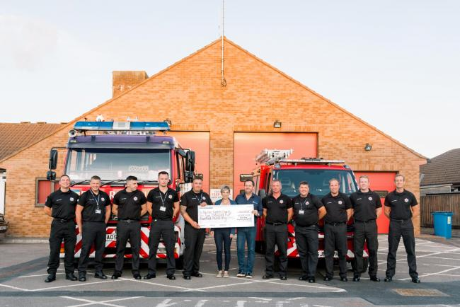 HELP: Ann and Steve Wells present the cheque to Williton firefighters