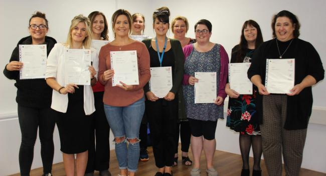 PROUD: The Musgrove staff members and their certificates
