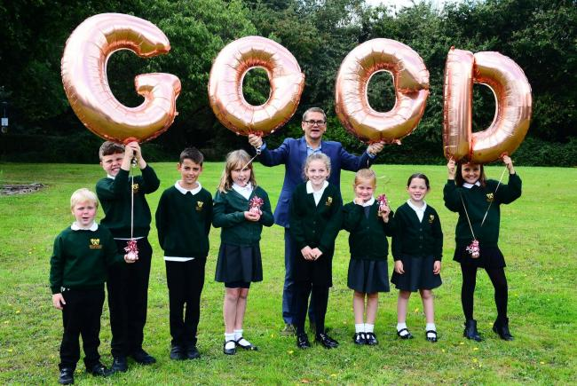 PROUD: Headteacher Mark Lunn with pupils celebrating their Ofsted results