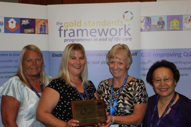 PLEASED: Carol Edwards, Camelot Care operations director; Sam Paddon, registered manager, Alison Southcott, GSF clinical lead, Angela Teasdale, owner Camelot Care