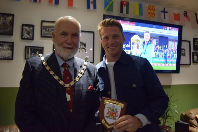 ACCOLADE: Jos Buttler receives his award from Cllr Nigel Taylor