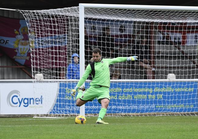 UNCHARACTERISTIC: A rare mistake from Taunton Town goalkeeper Lloyd Irish enabled Salisbury to open the scoring. Pic: Colin Andrews