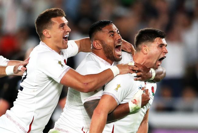 England's Ben Youngs (right) celebrates scoring a try with Henry Slade (left) and Manu Tuilagi but it is later ruled out following a TMO decision during the 2019 Rugby World Cup Semi Final match at International Stadium Yokohama. PA Photo. Picture da