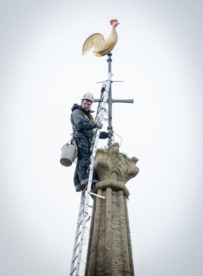 HEAD FOR HEIGHTS: The steeplejack at St Mary's Church, Bridgwater. PICTURES: Les Pickersgill