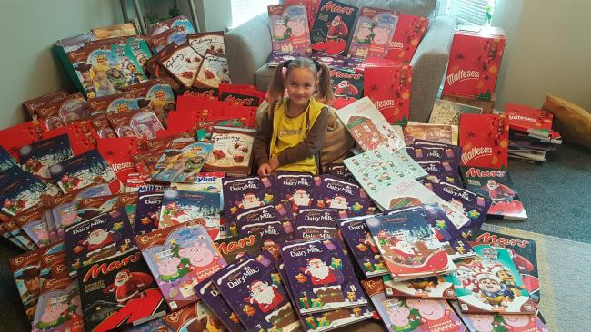 Holly with her advent calendar donations for Taunton Foodbank