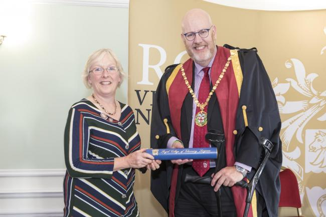 PROUD: Deborah Holland, from Cave Veterinary Specialists in Somerset, receiving her lifetime contribution to veterinary nursing award from RCVS president, Dr Niall Connell