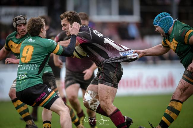 CLASH: Taunton, and centre Tom Popham, found Bury St Edmunds to be a slippery opponent on Saturday. Pic: Clayton Jane Photography