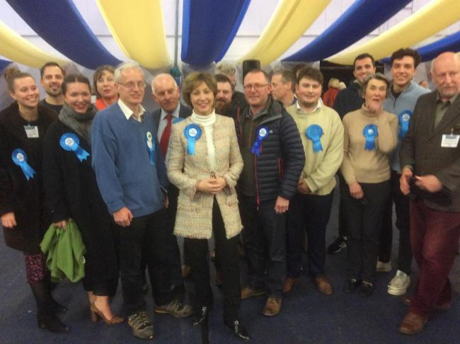 CELEBRATION: Rebecca Pow with Conservative Party supporters at the count