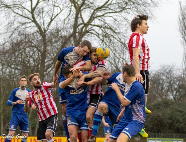 LEAP: Owen Irish (right, in red and white kit) in action for Bridgwater Town. Pic: Debbie Gould