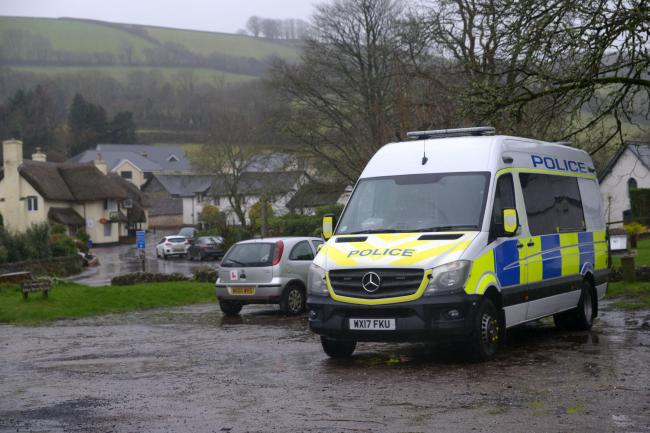 Police vehicles in Winsford, Somerset after the suspected murder of a woman