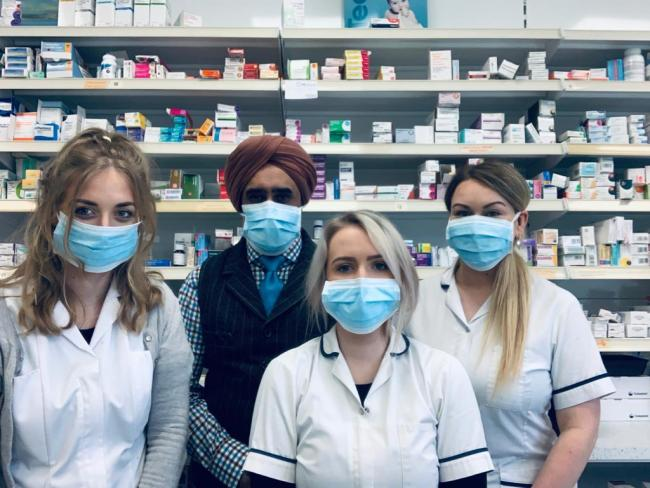 BE PATIENT: Mr Punni as his staff members at South Petherton Pharmacy