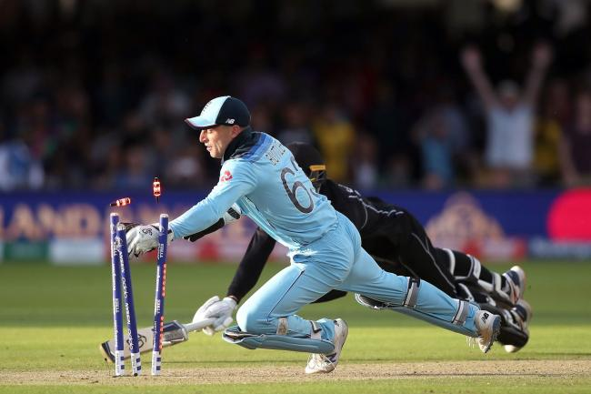 HEROICS: Jos Buttler completes the run-out that wins England the World Cup. Pic: PA Wire