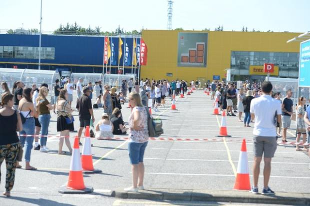 Somerset County Gazette: Customers queued two metres apart to get inside Ikea in Lakeside, Essex. Picture: Nick Ansell/PA Wire
