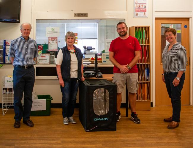 Brian Blelloch Treasurer to The League of Friends of Wellington Hospital and Chair Annette Cardwell hand over the 3D printer to Court Fields Head of Design Technology Ian Keitch and Acting Headteacher Polly Matthews.