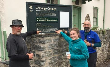 AMAZING EFFORT: The trio celebrate reaching Coleridge Cottage, more than 24 hours after they set out from Lynmouth