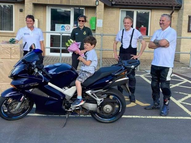 Somerset County Gazette: Dave and Joe presenting Tors Bush and her son Seth with some flowers as a thank you for all her help in coordinating the ride
