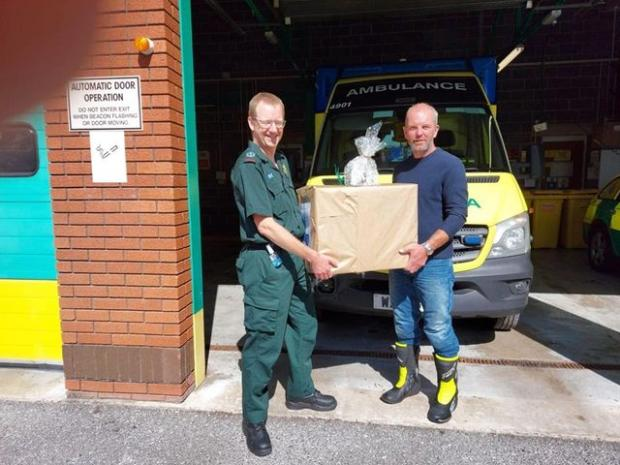 Somerset County Gazette: Nigel Calvert presenting a hamper at Burnham-on-Sea station