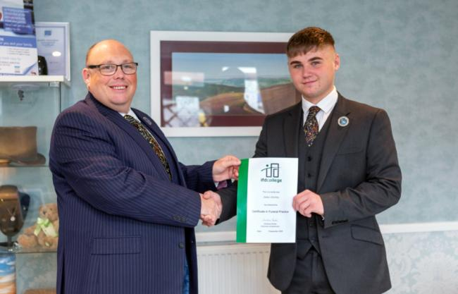 CONGRATULATIONS: James, right, receives his certificate from Simon Helliar-Moore of Crescent Funeral Services
