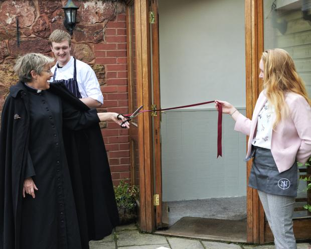 Somerset County Gazette: Rev Helene Stainer , Rector of Halse, Milverton , Fitzhead and Ash Priors cuts the ribbon to open the New Inn