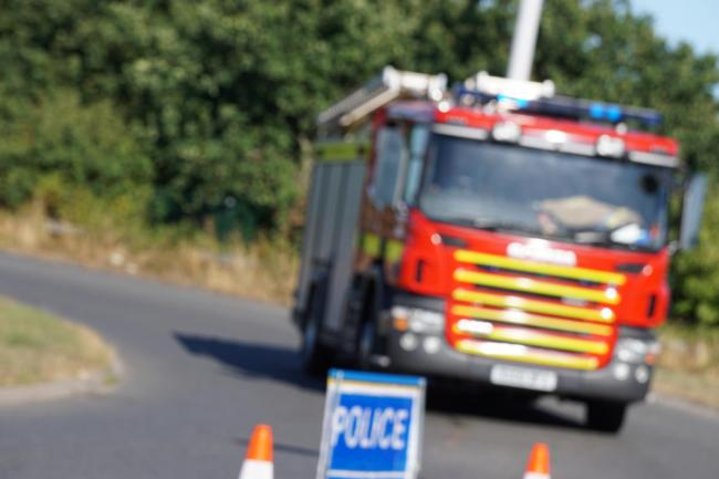 Fire engine and police sign - stock photo.