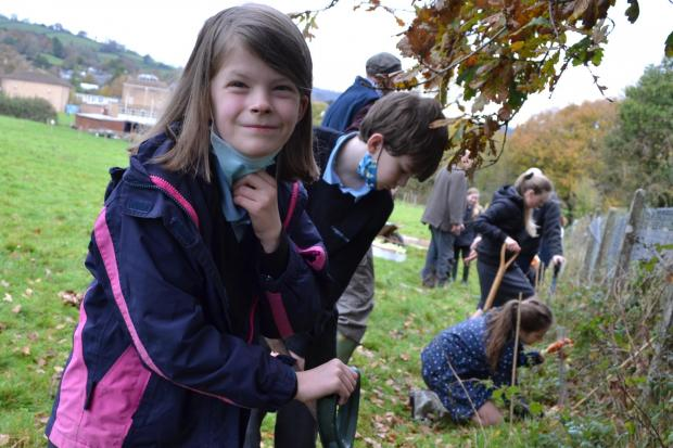 EFFORT: Youngsters helped plant saplings