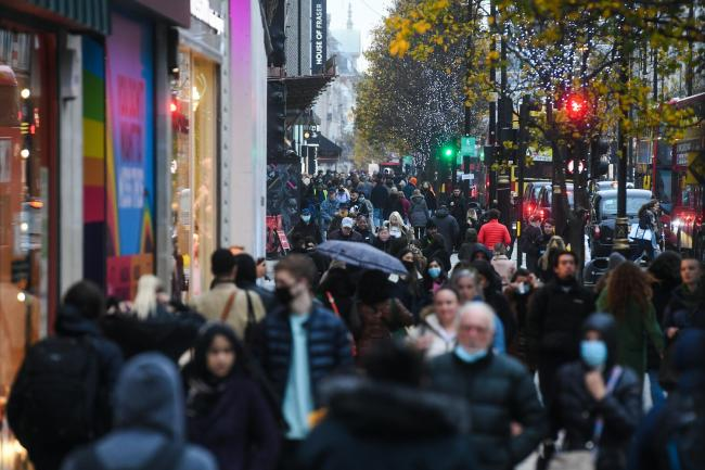 Shoppers on Oxford Street in London, as non-essential shops in England open their doors to customers for the first time after the second national lockdown ends