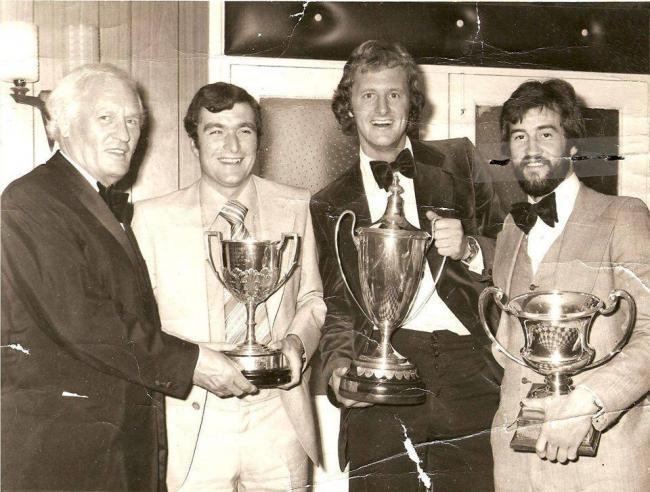 RECOGNITION: Southern League secretary Tony Dellow pictured at Minehead's Annual Dinner with top goalscorers Derek Bryant, Andy Leitch and Jimmy Jenkins, who had scored 96 goals between them in 1976-77