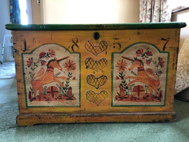 Somerset County Gazette: ORNAMENTAL: A continental painted chest with unicorns dated 1857, £200-£400