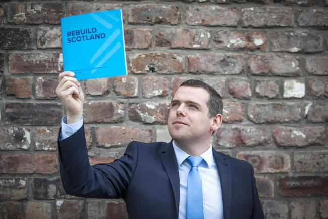 Douglas Ross holding up the 2021 Tory manifesto