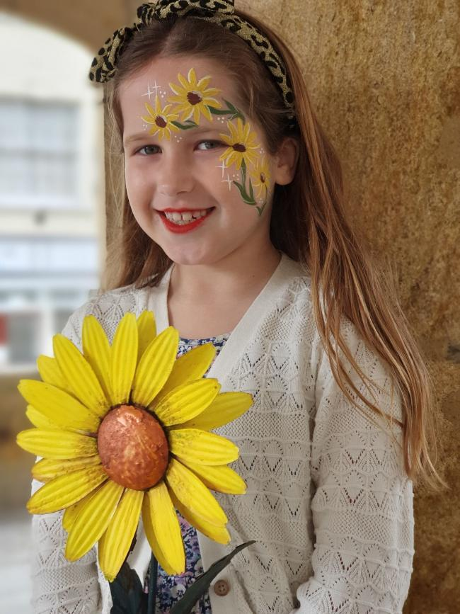 JOY: Heidi holding a sunflower. Pic:Sunflowers of Somerset Community Project