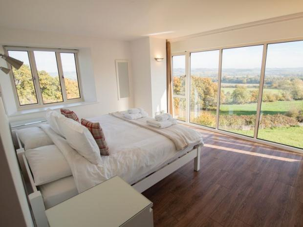 Somerset County Gazette: Bedroom view from Syke Cottages Cotswolds