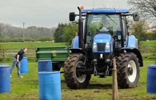 Somerset County Gazette: Competitors take part in the tractor handling event at the Ryedale rally