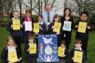 Pictured at the presentation are pupils who contributed artwork to the banner with organisers