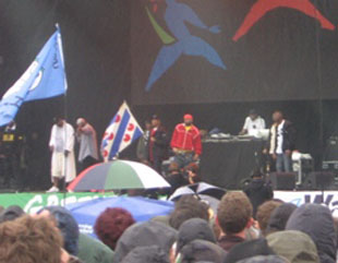Glastonbury 2011: Rappers wow rain-soaked crowds