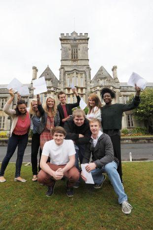 Queen's College students celerbate their success.