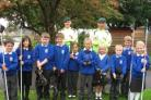 Two marines with pupils from Bishop's Hull Primary
