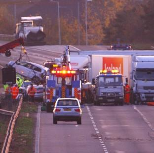 Somerset County Gazette: Cars are removed from the scene of the multiple vehicle crash on the M5 motorway close to Taunton