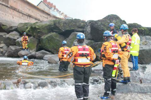 Coastguards during a training session where the dog drowned on West Street Beach in Watchet
