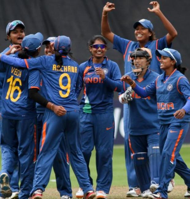INDIA's women celebrate victory. PHOTO: Tom Smith